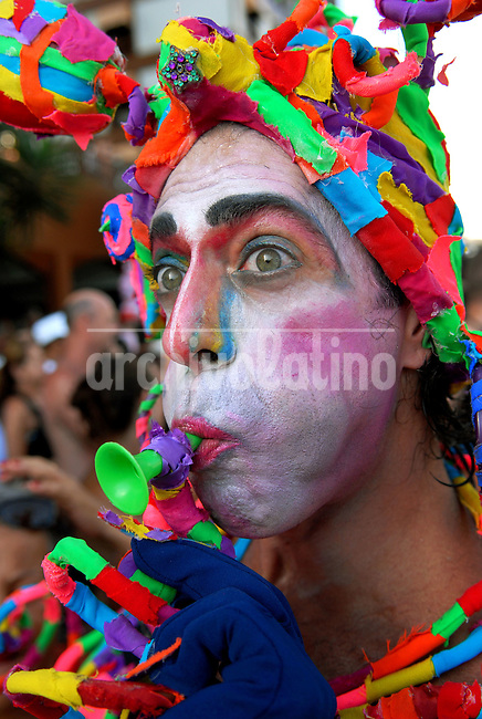 A reveler participates at carnival festivities during a carnival parade of the traditional Banda de Ipanema in a Ipanema's street, Rio de Janeiro, Brazil, February 7, 2009. Hundreds gathered for the annual 'Band of Ipanema' samba parades through the beachfront, the city's most famous street party of the year.