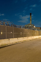 AVAILABLE FROM JEFF AS A FINE ART PRINT.<br /> <br /> AVAILABLE FROM PLAINPICTURE FOR COMMERCIAL AND EDITORIAL LICENSING.  Please go to www.plainpicture.com and search for image # p5690185.<br /> <br /> Electric Transformers and Electric Power Plant at Night Behind Concrete Security Barriers, Brooklyn, New York City, New York State, USA