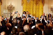 United States President Barack Obama speaks at a Hanukkah reception in the East room of the White House while Israeli President Reuven Rivlin (2R), US First Lady Michelle Obama (2L), Nechama Rivlin, the wife of Reuven Rivlin (L) and Rabbi  Susan Talve (R) listen, in Washington, DC, December 9, 2015. <br /> Credit: Aude Guerrucci / Pool via CNP
