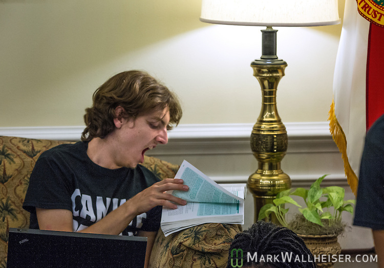 TALLAHASSEE, FL - AUGUST 5, 2013:   Dream Defender Zachary Schultz, 18 year-old from Sarasota, Florida, yawns as he studies his sociology during an open forum discussions in the lobby of the governor's office at the Florida State Capitol.  The Dream Defenders have been occupying the governors office and the state capitol 24 hours a day for 21 consecutive days protesting Florida's Stand Your Ground law.