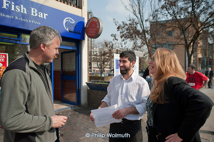 Shop owner Yaquub Aiobi, Helen Kay (PT) and sign-maker Keron Kent with new shop signage on Westbourne parade, Harrow Road.