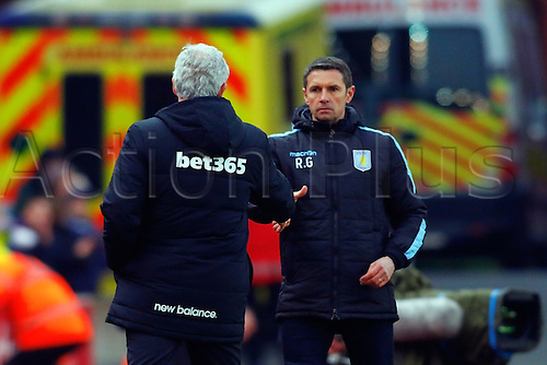 27.02.2016. Britannia Stadium, Stoke, England. Barclays Premier League. Stoke City versus Aston Villa. Aston Villa Manager Remi Garde and Stoke City Manager Mark Hughes shake hands at the end of the game