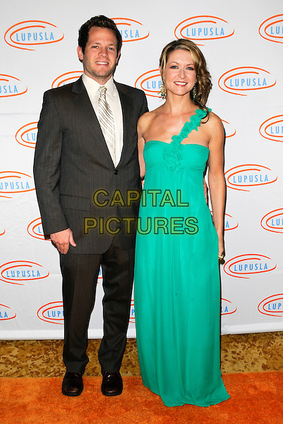 MATT SCWARTZ & ALI HILLIS.Lupus LA Orange Ball 2010 held at the Beverly Wilshire Hotel, Beverly Hills, California, USA..6th May 2010. .full length green one shoulder strap maxi dress married husband wife grey gray suit tie.CAP/ROT.©Lee Roth/Capital Pictures