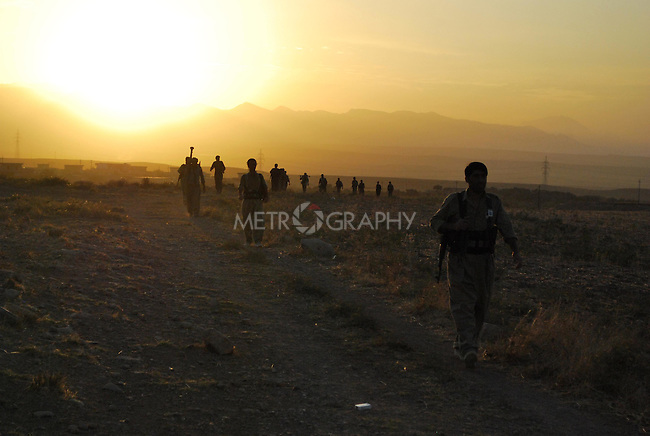 KOYA, IRAQ: In the morning KDP-Iran guerrillas leave their base to go on a military training in the Iraqi mountains...Peshmerga, military irregulars, of the Democratic Party of Iranian Kurdistan (KDP-Iran) train in the mountains of Iraq...Photo by Aram Karim/Metrography