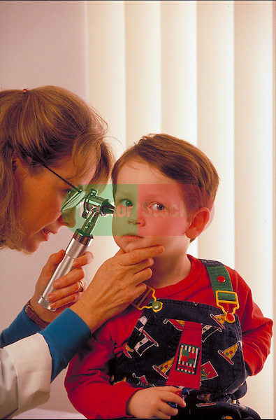 female doctor examining toddler boy's ear with otoscope