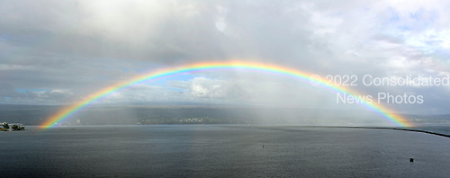 Full rainbow over the harbor in Hilo, Hawaii on Monday, February 25, 2013..Credit: Ron Sachs / CNP