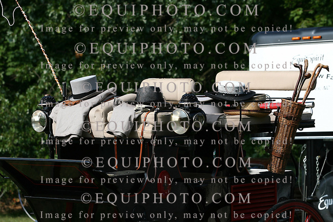 Hats sit on the seat of a coach before four in hand coaching event in Locust, New Jersey.