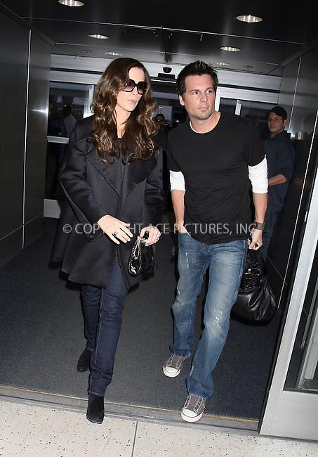 WWW.ACEPIXS.COM ** ** ** ....exclusive coverage, all rounder....March 13 2008, New York City....Actress Kate Beckinsale and her director husband Len Wiseman arrive at JFK airport.....Please byline: Philip Vaughan -- ACEPIXS.COM.. *** ***  ..Ace Pictures, Inc:  ..tel: (646) 769 0430..e-mail: info@acepixs.com..web: http://www.acepixs.com