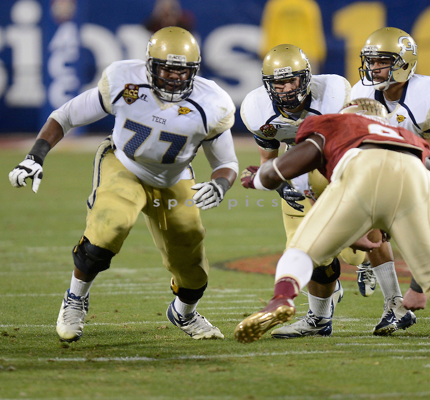 Georgia Tech Yellowjackets Omoregie Uzzi (77) in action during the 2012 ACC Championship game against Florida State on December 1, 2012 at Bank of America Stadium in Charlotte, NC. Florida State beat Georgia Tech 21-15.