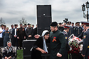 During the parade celebrating the 65th anniversary of Soviet victory in World War II, Chechen leader Ramzan Kadyrov greets the widow of a policemen killed in clashes with rebels. Grozny, Chechnya, Russia, 2010