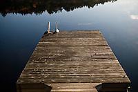 Mississauga Lake reflection with boat dock.