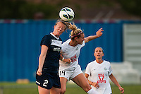 Sky Blue FC defender CoCo Goodson (2) goes up for a header with FC Kansas City defender Lauren Sesselmann (14). Sky Blue FC and FC Kansas City played to a 2-2 tie during a National Women's Soccer League (NWSL) match at Yurcak Field in Piscataway, NJ, on June 26, 2013.