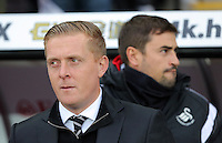 (L-R) Swansea manager Garry Monk with assistant Josep Pep Clotet during the Barclays Premier League match between Swansea City and Bournemouth at the Liberty Stadium, Swansea on November 21 2015