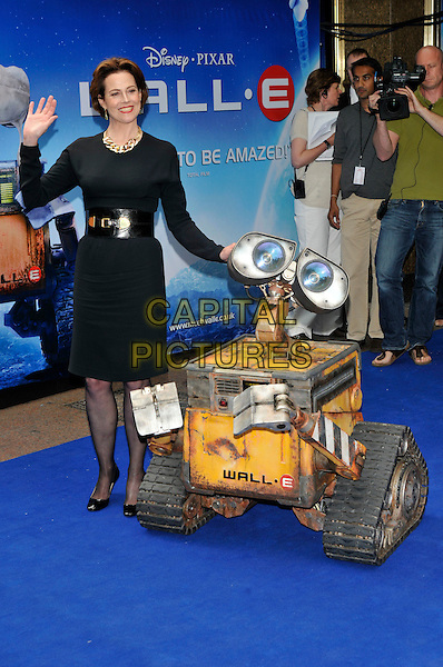 "SIGOURNEY WEAVER & WALL-E THE ROBOT  .UK Premiere of ""Wall-E"" at the Empire, Leicester Square, London, England. .July 13th, 2008.full length black dress belt robot hand palm waving machine .CAP/PL.©Phil Loftus/Capital Pictures."