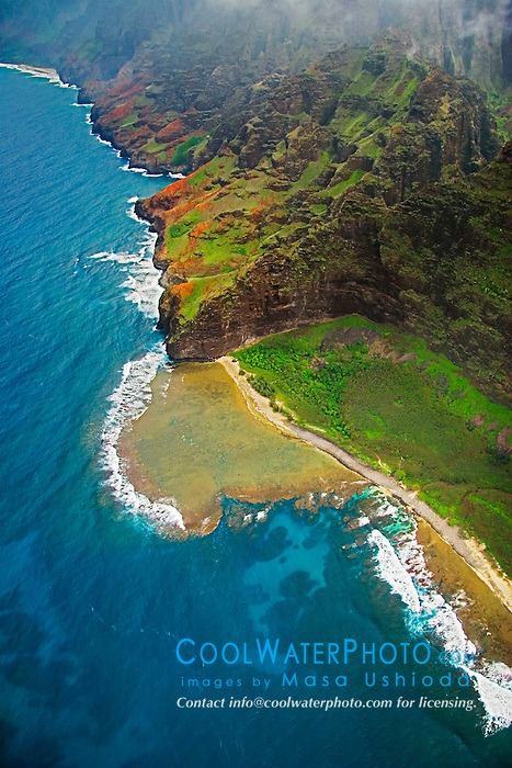 """Fat Man's Misery"" rock and coral reef at Nu`alolo Kai or Nualolo Kai beach, only accessible by boat or by air, Na Pali coast, Kauai, Hawaii"