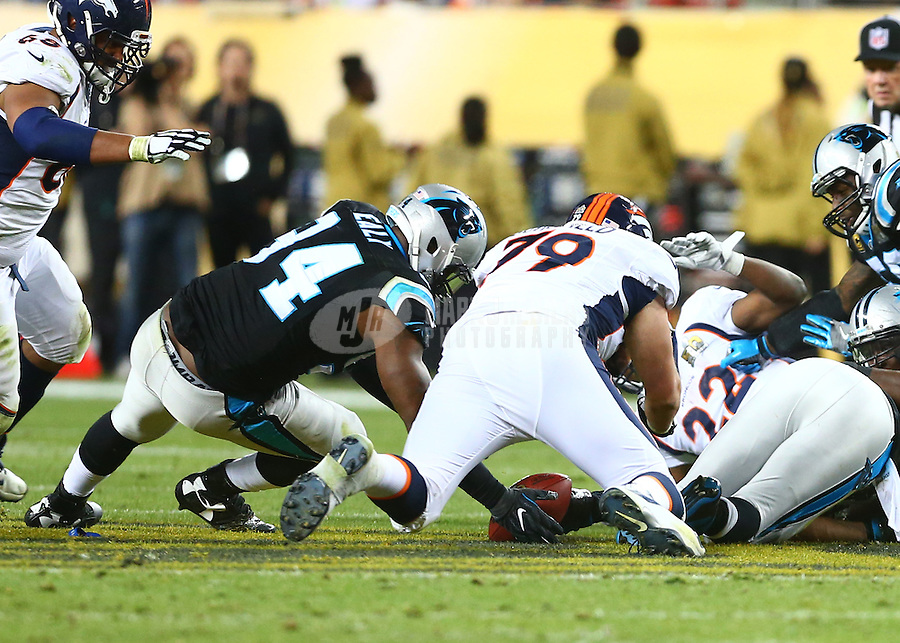Feb 7, 2016; Santa Clara, CA, USA; Denver Broncos offensive tackle Michael Schofield (79) and Carolina Panthers defensive end Kony Ealy (94) dive for a loose ball in Super Bowl 50 at Levi's Stadium. Mandatory Credit: Mark J. Rebilas-USA TODAY Sports