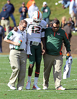 Medical staff attend to Miami Hurricanes quarterback Jacory Harris (12) during the 1st half of the game at Scott Stadium.  Mandatory Credit: Andrew Shurtleff