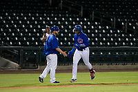 AZL Cubs left fielder Nelson Velazquez (20) is congratulated by third base coach Ben Carhart while rounding the bases after hitting a home run against the AZL Padres 2 on August 28, 2017 at Sloan Park in Mesa, Arizona. AZL Cubs defeated the AZL Padres 2 9-4. (Zachary Lucy/Four Seam Images)