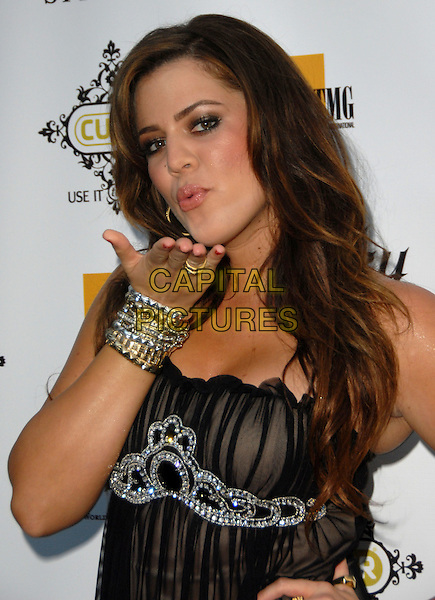 "KHLOE KARDASHIAN  .TMG International/CUUR Annual ""Style LA"" Fashion Runway Show held at the Viceroy Hotel, Santa Monica, California, USA, 28 July 2008. .half length hand blowing kiss red nails bracelets bangles silver gold ring .CAP/ADM/FS.©Faye Sadou/Admedia/Capital Pictures"