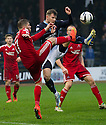 Aberdeen's David Goodwillie and Dundee's Willie Dyer challenge for the ball.