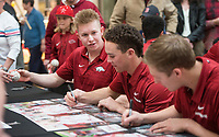 NWA Democrat-Gazette/BEN GOFF @NWABENGOFF<br /> Heston Kjerstad (left), Arkansas outfielder, and other players sign autographs for fans Saturday, Feb. 9, 2019, during Arkansas baseball's annual Meet the Razorbacks Day at Northwest Arkansas Mall in Fayetteville.