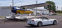 A vintage bush plane sits partially disassembled at the Sarnia Bay Marina parking lot.