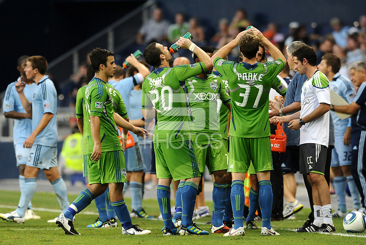 Seattle Sounders players' take a water break duruing a stoppage in play... Sporting Kansas City were defeated 1-2 by Seattle Sounders at LIVESTRONG Sporting Park, Kansas City, Kansas.