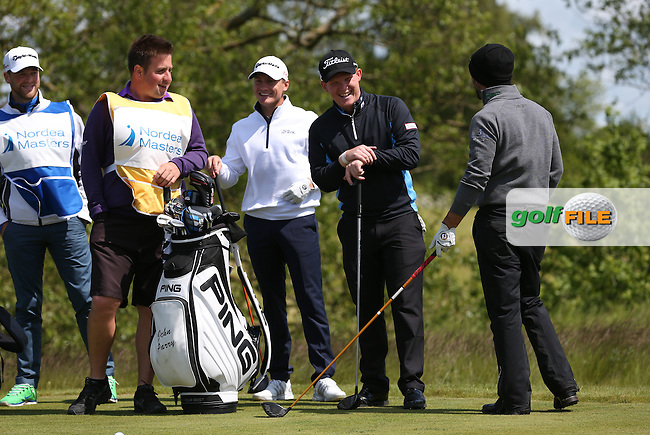 Enjoying the craic are Chris Lloyd (ENG), John Parry and Pontus Widegren (SWE) with caddies during Round One of the 2015 Nordea Masters at the PGA Sweden National, Bara, Malmo, Sweden. 04/06/2015. Picture David Lloyd | www.golffile.ie