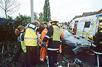 Emergency service personnel attend RTA where the driver lost control of his vehicle and hit a lamppost. They will rush the casualty on a stretcher to the awaiting HEMS helicopter that is based at the Royal London Hospital..This image may only be used to portray the subject in a positive manner..© shoutpictures.com.john@shoutpictures.com