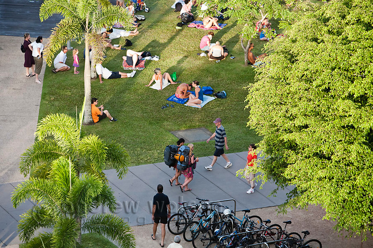 Sunbathers and tourists on the lawns of the Esplanade Lagoon.  Cairns, Queensland, AUSTRALIA