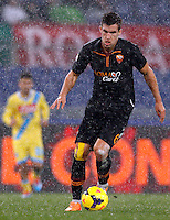 Calcio, semifinale di andata di Coppa Italia: Roma vs Napoli. Roma, stadio Olimpico, 5 febbraio 2014.<br /> AS Roma midfielder Kevin Strootman, of the Netherlands, in action during the Italian Cup first leg semifinal football match between AS Roma and Napoli at Rome's Olympic stadium, 5 February 2014.<br /> UPDATE IMAGES PRESS/Riccardo De Luca