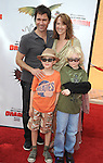 UNIVERSAL CITY, CA. - March 21: Eric McCormack, son Finnigan, wife Janet arrive at the premiere of ''How To Train Your Dragon'' at Gibson Amphitheater on March 21, 2010 in Universal City, California.