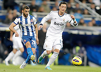 Real Madrid's Mesut Özil against Espanyol's Simao Sabrosa during La Liga match. December 16, 2012. (ALTERPHOTOS/Alvaro Hernandez)