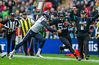 3rd November 2019; Wembley Stadium, London, England; National Football League, Houston Texans versus Jacksonville Jaguars; Bryan Anger of Houston Texans tackles Linebacker Malcolm Smith of Jacksonville Jaguars - Editorial Use