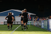 The referees warm up before the match. The women's national team of the United States defeated Canada 6-0 during an international friendly at Robert F. Kennedy Memorial Stadium in Washington, D. C., on May 10, 2008.