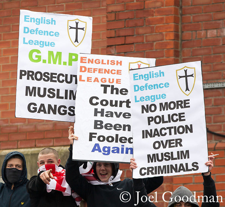 © Joel Goodman - 07973 332324 . 25/02/2012 . Hyde , UK . The EDL demonstrate following an assault on Daniel Stringer-Prince, whose family say they do not want the demonstration to take place in the town in their son's name. The EDL say Daniel was assaulted by a gang of Asian men . At the same time , the BNP hold a rally in the town . Photo credit : Joel Goodman