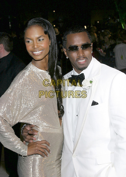 KIM PORTER & SEAN COMBS - P DIDDY.2005 Vanity Fair Oscar Party held at Morton's Restaurant. West Hollywood, CA.February 27th, 2005.Photo Credit: Jacqui Wong/AdMedia.half length arm around waist corsage tuxedo sunglasses shades .www.capitalpictures.com.sales@capitalpictures.com.© Capital Pictures.