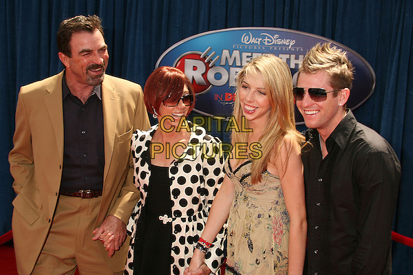 "TOM SELLECK & FAMILY .""Meet The Robinsons"" Los Angeles Premiere at the El Capitan Theatre, Hollywood, California, USA..March 25th, 2007.half length brown black white polka dot suit jacket sunglasses shades holding hands.CAP/ADM/BP.©Byron Purvis/AdMedia/Capital Pictures"