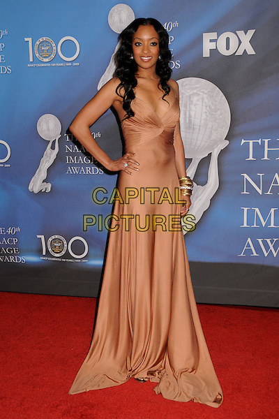 JENNIA FREDRIQUE.40th Annual NAACP Image Awards - Arrivals at the Shrine Auditorium, Los Angeles, California, USA..February 12th, 2009.full length pink beige long silk satin dress hand on hip .CAP/ADM/BP.©Byron Purvis/AdMedia/Capital Pictures.
