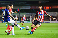 Lincoln City's Bruno Andrade, centre, and Lincoln City's Harry Toffolo, vies for possession with Everton's Djibril Sidibe<br /> <br /> Photographer Chris Vaughan/CameraSport<br /> <br /> The Carabao Cup Second Round - Lincoln City v Everton - Wednesday 28th August 2019 - Sincil Bank - Lincoln<br />  <br /> World Copyright © 2019 CameraSport. All rights reserved. 43 Linden Ave. Countesthorpe. Leicester. England. LE8 5PG - Tel: +44 (0) 116 277 4147 - admin@camerasport.com - www.camerasport.com