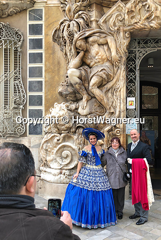 Valencia-Spain, January 14, 2018; <br /> woman in traditional, local costume poses at the rococo style - alabaster entrance of the Gonz&aacute;lez Mart&iacute; National Museum of Ceramics and Decorative Arts;<br /> Photo &copy; HorstWagner.eu
