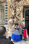 Valencia-Spain, January 14, 2018; <br /> woman in traditional, local costume poses at the rococo style - alabaster entrance of the González Martí National Museum of Ceramics and Decorative Arts;<br /> Photo © HorstWagner.eu