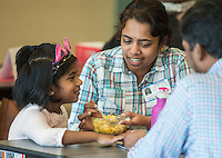 NWA Democrat-Gazette/ANTHONY REYES @NWATONYR<br /> Priya Ram eats lunch with her daughter Shreya Ram's, 5, mouth Friday, Feb. 3, 2017 while eating lunch at Willowbrook Elementary School in Bentonville. More parents have taken the time to occasionally eat lunch with their children at school.