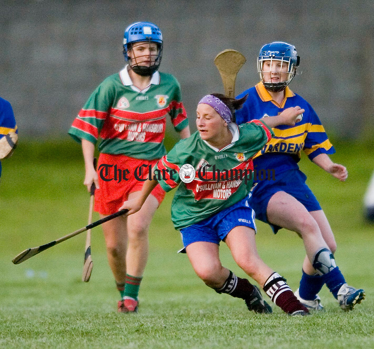 Clooney's Caroline Lee gets away from Newmarket's Sinead Ryan during their game in Clareabbey. Photograph by John Kelly.