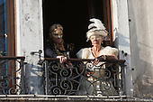 Venice, Italy, 8 February 2015. Two women in costume watch people in St Mark's Square. People wear traditional masks and costumes to celebrate the 2015 Carnival in Venice. carnivalpix/Alamy Live News