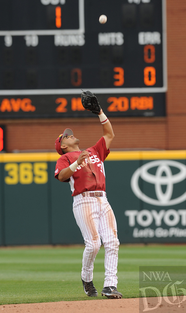 NWA Democrat-Gazette/ANDY SHUPE - Michael Bernal of Arkansas fields a popup against LSU during the fifth inning Saturday, March 21, 2015, at Baum Stadium in Fayetteville. Visit nwadg.com/photos for more photos from the game.