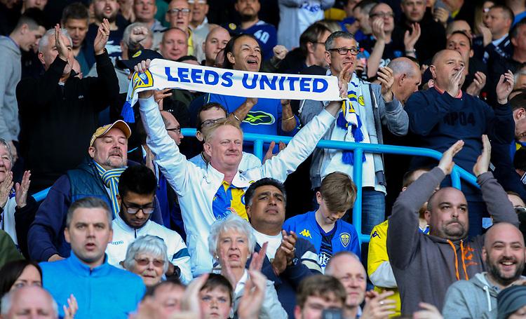 Leeds United fans celebrate the win<br /> <br /> Photographer Alex Dodd/CameraSport<br /> <br /> The EFL Sky Bet Championship - Leeds United v Millwall - Saturday 30th March 2019 - Elland Road - Leeds<br /> <br /> World Copyright © 2019 CameraSport. All rights reserved. 43 Linden Ave. Countesthorpe. Leicester. England. LE8 5PG - Tel: +44 (0) 116 277 4147 - admin@camerasport.com - www.camerasport.com