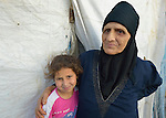 Ayush Nadir stands with her 12-year old granddaughter Zahara in front of their tent in a settlement of Syrian refugees in Minyara, a village in the Akkar district of northern Lebanon. Lebanon hosts some 1.5 million refugees from Syria, yet allows no large camps to be established. So refugees have moved into poor neighborhoods or established small informal settlements in border areas. International Orthodox Christian Charities, a member of the ACT Alliance, provides support for families in this settlement.