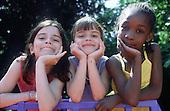 Three friends at a Camden Council summer playscheme.