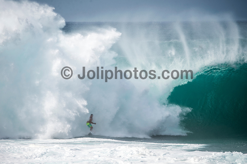 BANZAI PIPELINE, Oahu/Hawaii (Saturday, December 13, 2014)  Jason Frederico (HAW)  at Pipeline after the contest was called off for the day. - The final stop of the 2014  World Championship Tour, the Billabong Pipe Masters in Memory of Andy Irons, was  called ON today in NW double overhead surf. <br /> Round 1 was completed as the swell continued to rise and the Easterly Trade winds increased in strength. Kelly Slater (USA) kept his World Title hopes alive after winning his heat against Reef MacIntosh (HAW). Jordy Smith(ZAF) was injured when he hit the reef at Backdoor.<br /> Conditions worsen around the end of the Round and the event was first put on hold then postponed for the day.  <br /> <br /> The Billabong Pipe Masters in Memory of Andy Irons will determine this year&rsquo;s world surfing champion as well as those who qualify for the elite tour in 2015. As the third and final stop on the Vans Triple Crown of Surfing Series  the event will also determine the winner of the revered three-event leg.<br /> <br />  Photo: joliphotos.com